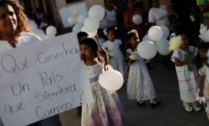 Children take part in a demonstration appealing for information about 43 missing students, in Tixtla